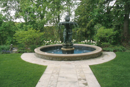 formalfountain is appropriately enhanced by a formal flagstone ...